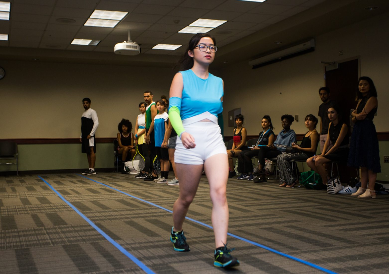 A model practices her runway walk in a Phua Lee design during rehearsal in the University Union Foothill Suite on Wednesday. (Photo by Nicole Fowler)