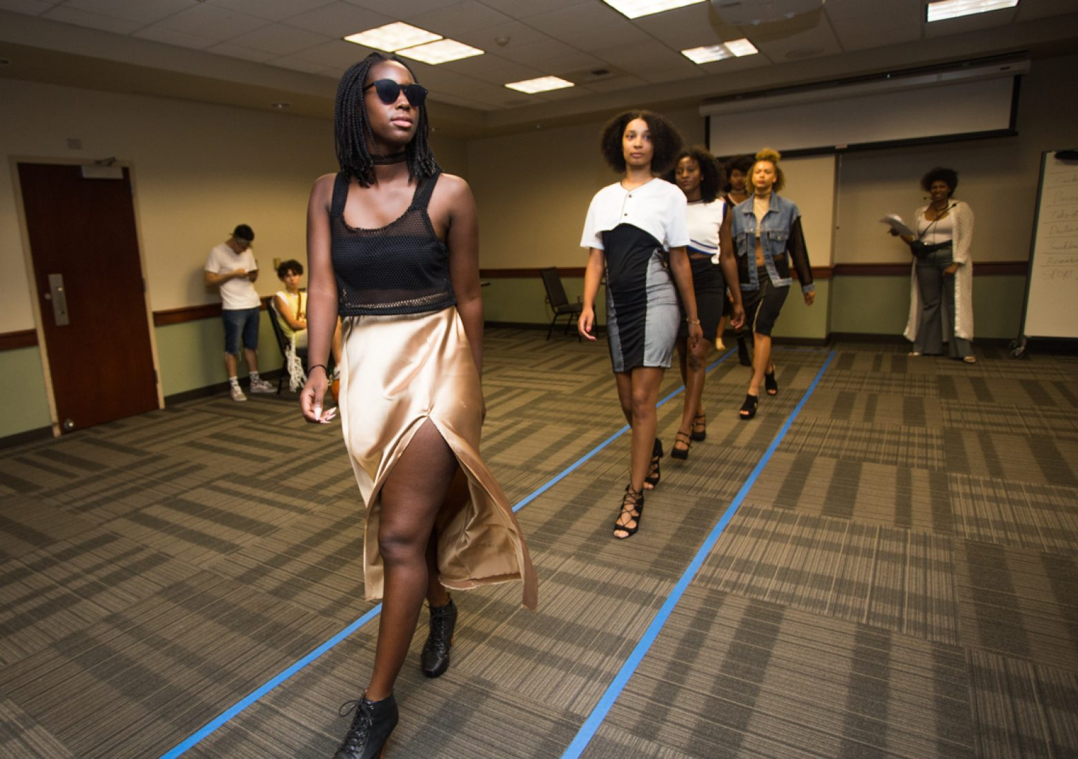 Models wear designs from Gabrielle Pyle's 'SPORT LUXXXE' collection strut to the upbeat music of 'Fade' by Kanye West during rehearsal in the University Union Foothill Suite on Wednesday. (Photo by Nicole Fowler)