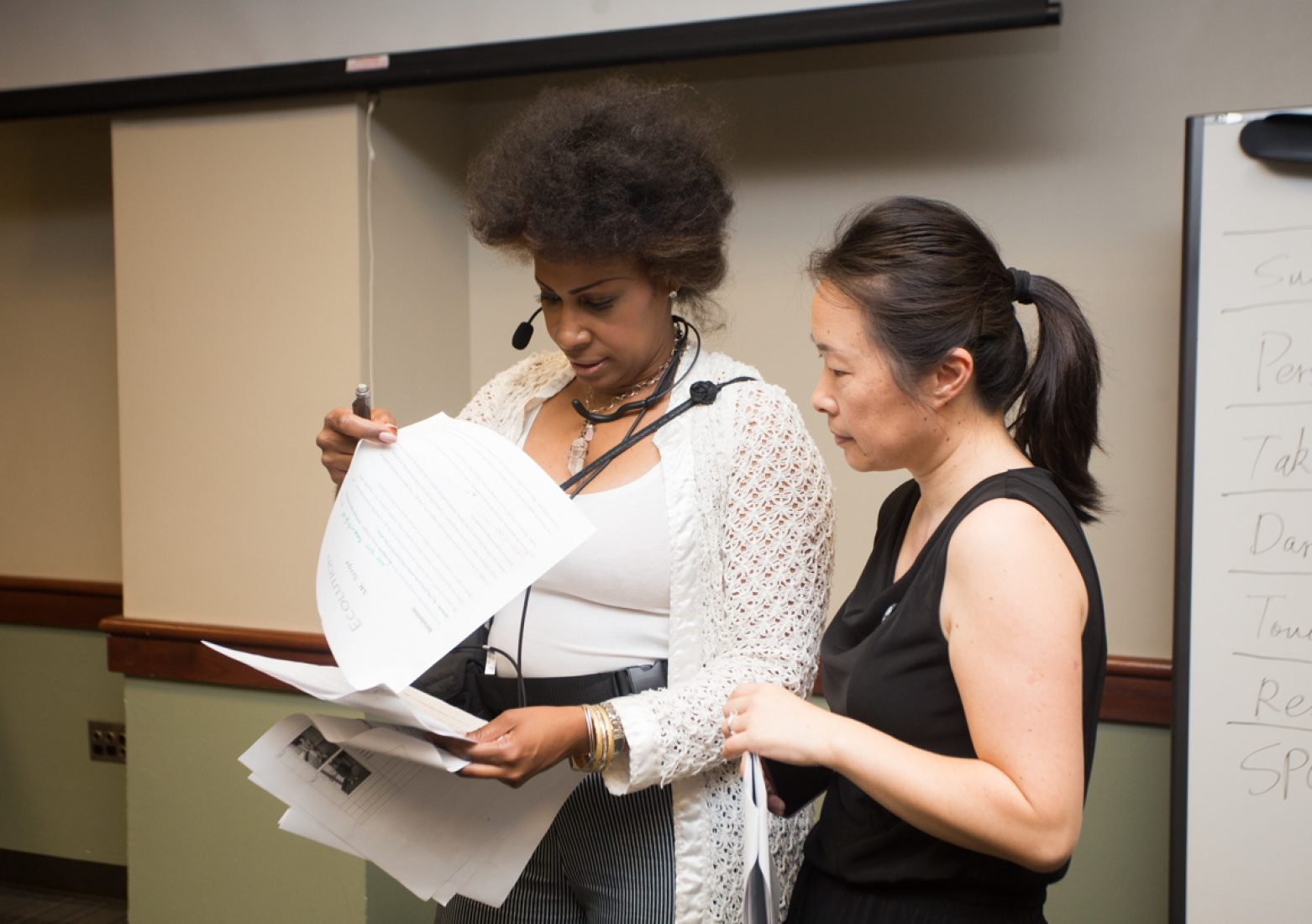 SFA faculty adviser Dong Shen goes over the show script with the event's host during rehearsal in the University Union Foothill Suite on Wednesday. (Photo by Nicole Fowler)
