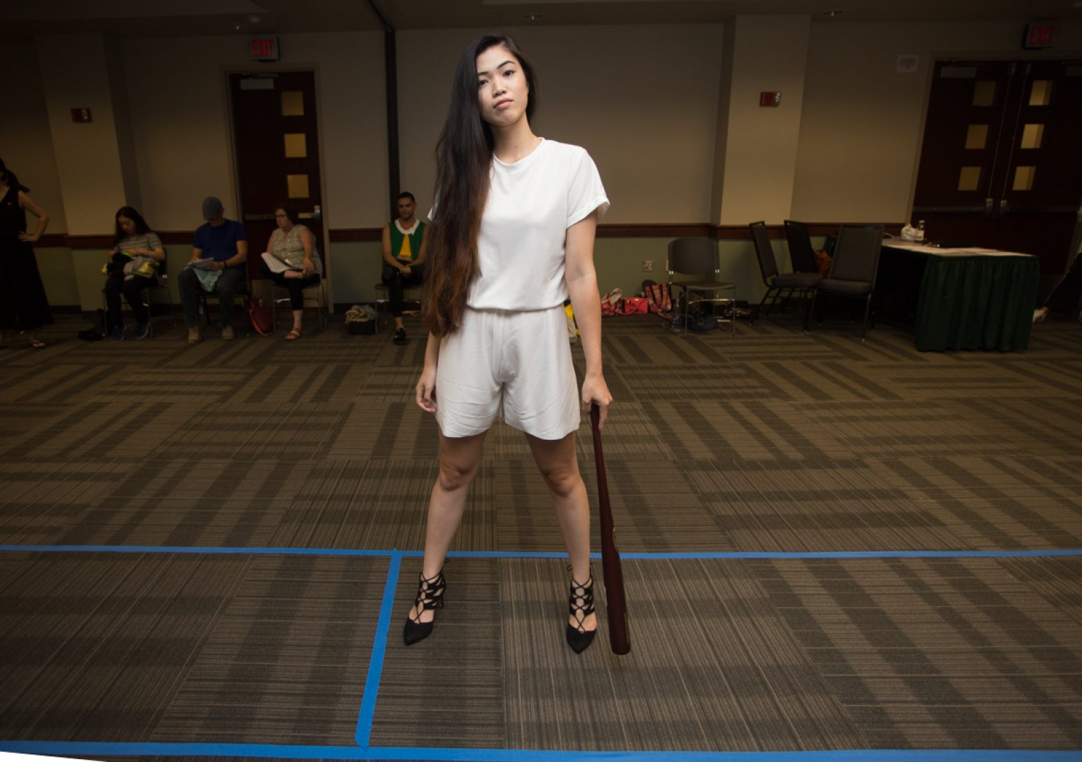 A model wears a design from Kristine Untalan's 'Darling' collection during rehearsal in the University Union Foothill Suite on Wednesday. Untalan's collection was inspired by baseball.(Photo by Nicole Fowler)