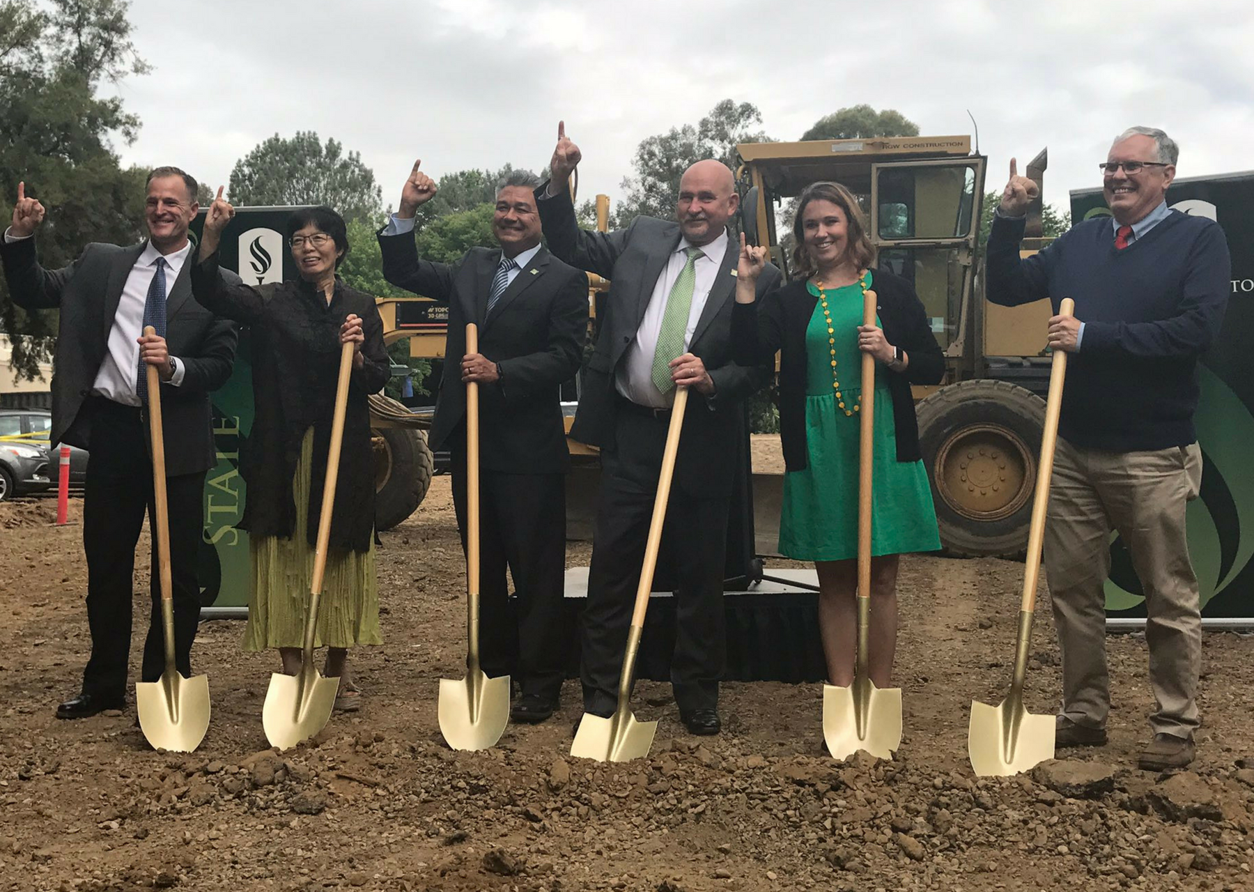Sacramento State staff and President Robert Nelsen, third from the left, hold golden shovels at groundbreaking ceremony for Parking Structure V on Friday. (Photo by Rin Carbin)