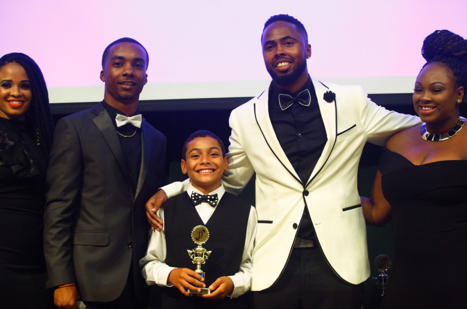 Chad Martinez, center, was one the 17 scholarship recipients awarded by Project Optimism at its first Black & White Gala on July 9 in the University Union Redwood Room at Sacramento State. (Photo by Nicole Fowler)