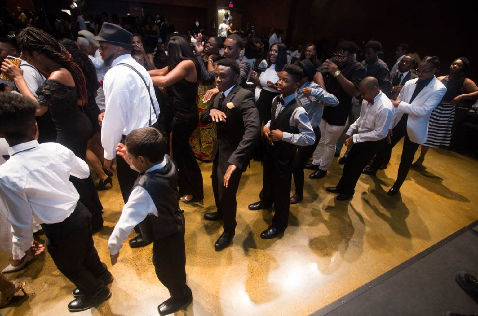 Guests take to the dance floor at an intermission session during Project Optimism's first Black & White Gala in the University Union Redwood Room on July 9. (Photo by Nicole Fowler)