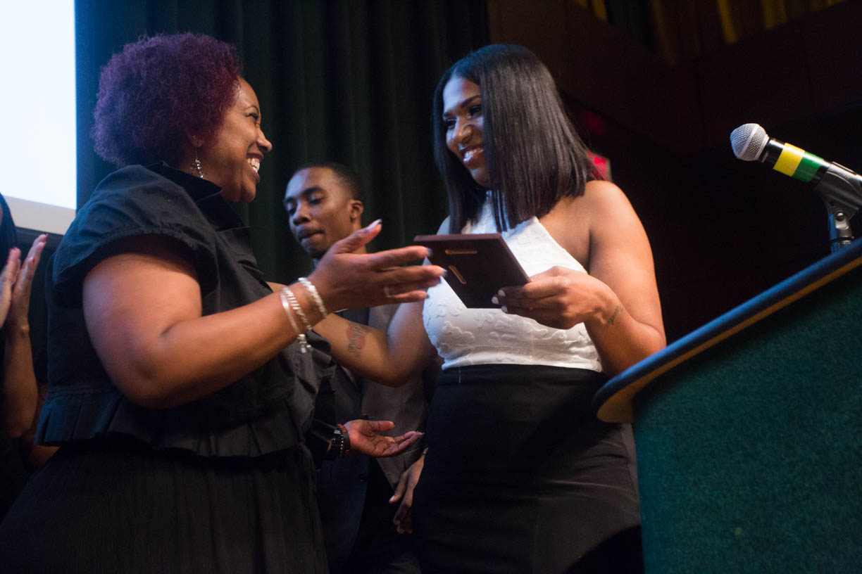 Yvonne Alexander, left, presents the Isaiah Alexander Award to Sacramento State student Chantiera Conley on July 9, at the Black & White Gala in the University Union Redwood Room. The award was given to the student who has overcome adversity and special circumstances while pursuing academics. (Photo by Nicole Fowler)