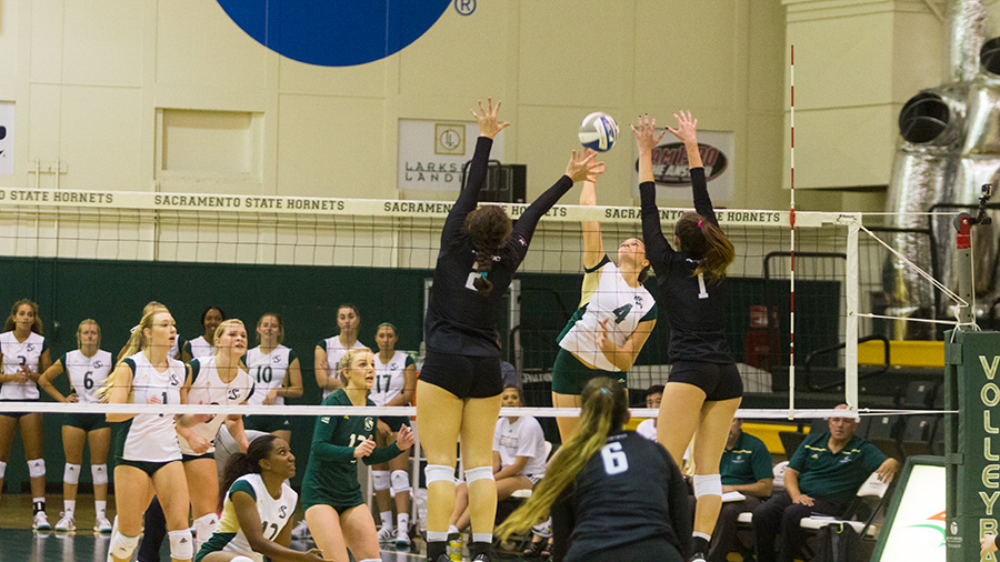 Sacramento State junior outside hitter Mikaela Nocetti goes for a spike against two blockers from the University of the Pacific Wednesday, Aug. 30 at Colberg Court. Sac Sate lost 3-1 for its second loss of the season.