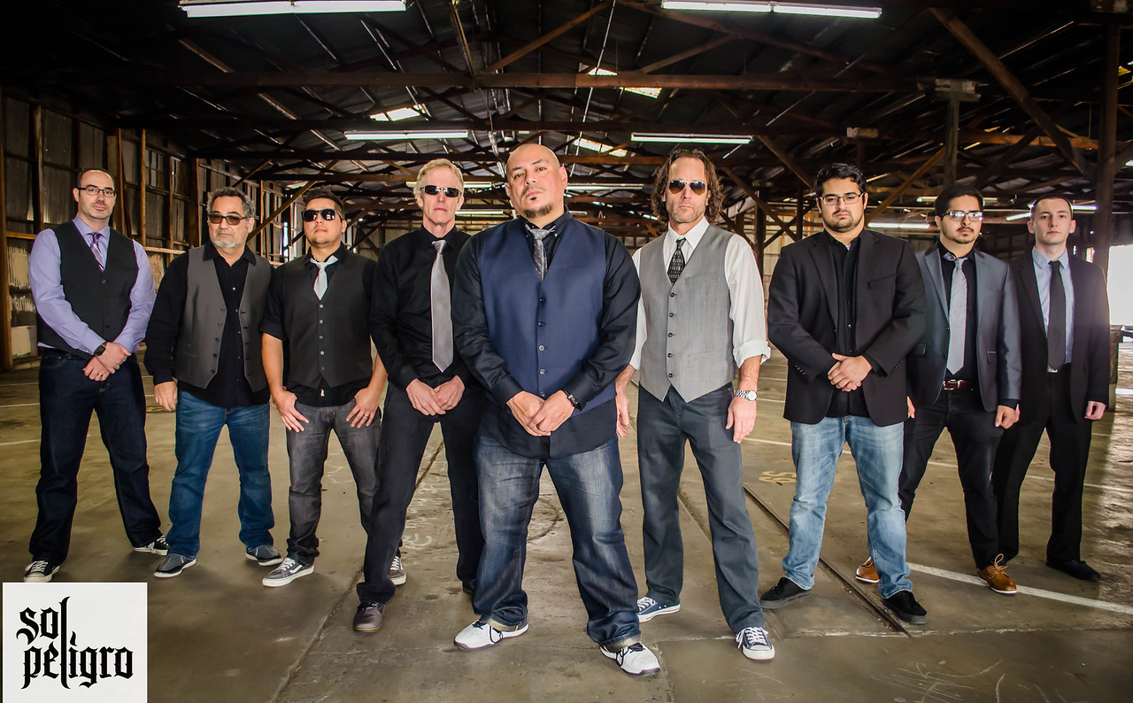From left to right, band-members Will Scharff, Todd Perez, Cesar Mena, Curtis Blakenship, Sam Miranda, Kenny Rego, Mario Bonilla, Richard Gonzalez and Marti Sarigul-Klijn of Latin reggae band Sol Peligro will perform their last performance of the year at the Nooner concert Sacramento State's Serna Plaza on Wednesday.