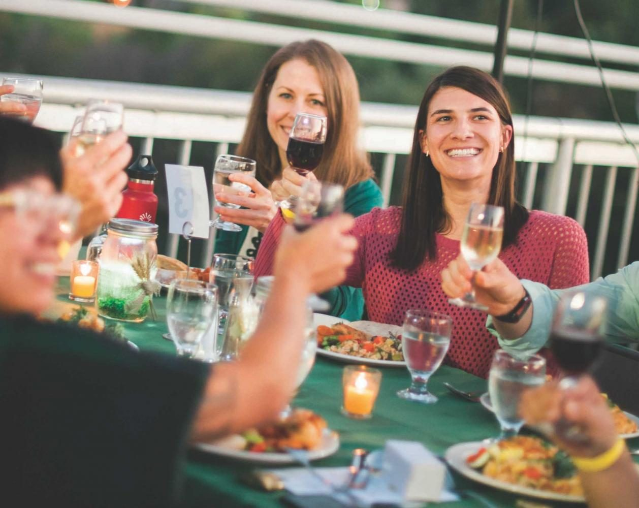 Diners raise their glasses during the first Farm-to-Fork dinner on the Guy West Bridge on Sept. 14, 2016. This years dinner will be held on Sept. 13.