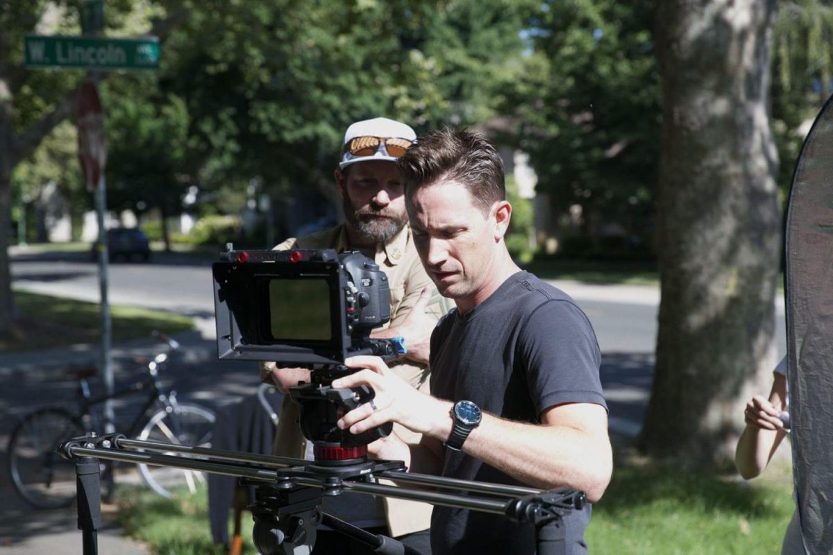 Director Adam Chollet, back, and cinematographer Stephen Chollet, front, shoot a scene for