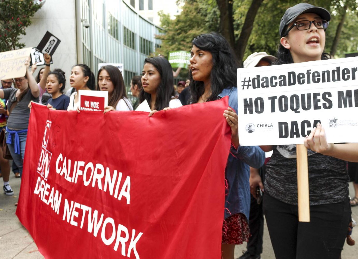 A crowd of local residents and Sac State students gather in downtown Sacramento Tuesday to protest, opposing the Trump administration's plans to eliminate DACA programs. (Photo by Claire Morgan)