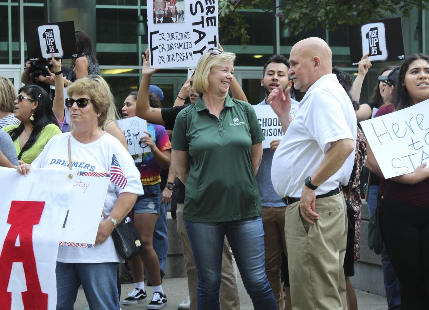 President Robert Nelsen and his wife Jody show their support for DACA recipients at the march in downtown Sacramento on Tuesday. (Photo by Claire Morgan)