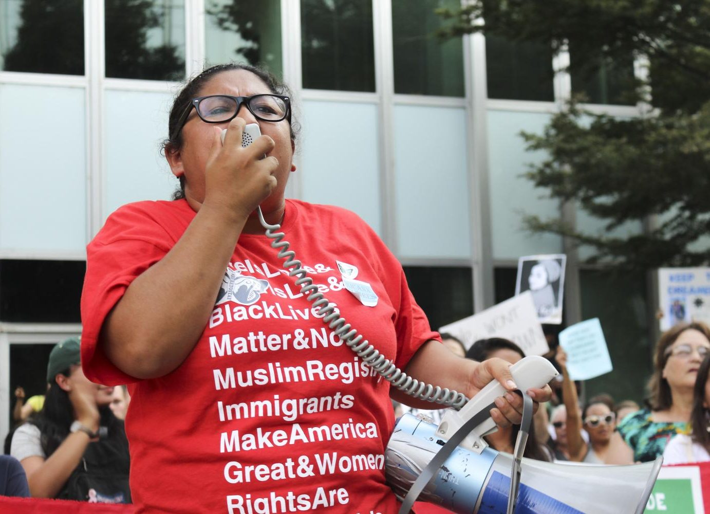 Rosa Barrientos protests on in downtown Sacramento Tuesday to oppose the Trump administration's plans to eliminate DACA programs. (Photo by Claire Morgan)
