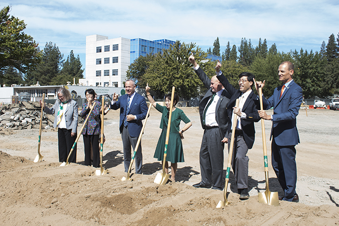 Public+officials+finish+taking+first+scoops+of+dirt+at+the+construction+site+where+the+new+science+building+is+going+to+be+during+the+groundbreaking+ceremony+on+Sept.+18.+Sacramento+State+President+said+that+it+took+three+years+for+the+new+building+to+get+off+the+ground.