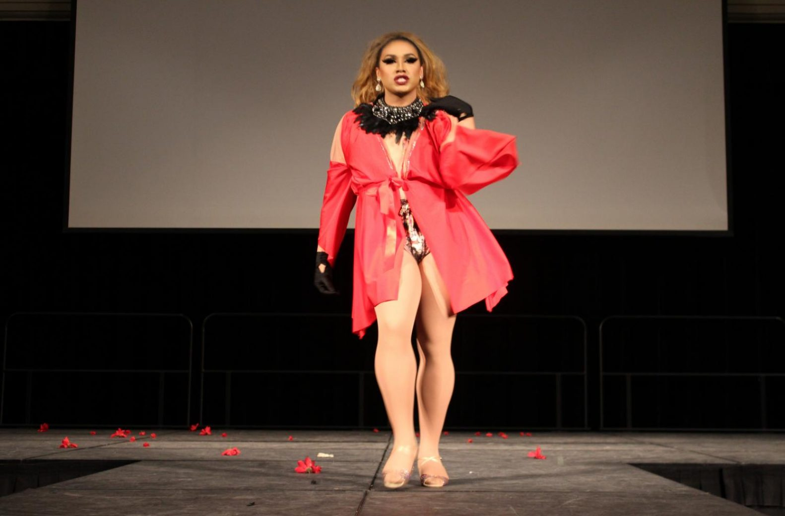 "Tatianna Diamond dances in a handmade red ensemble and feather necklace to a remix of ""A Woman's Got A Power"" by Jennifer Holliday. (Rin Carbin – The State Hornet)"