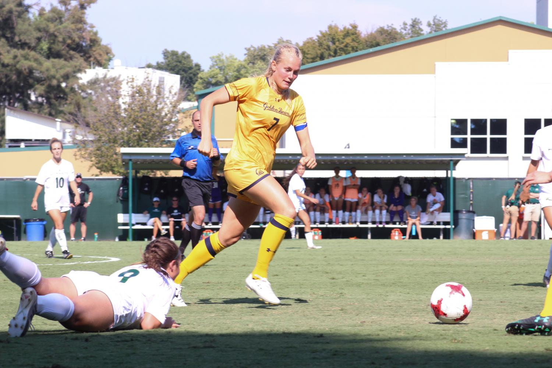 Cal senior midfielder beats sophomore midfielder Bonnie Ford for the ball Friday, Sept. 8 at Hornet Field.