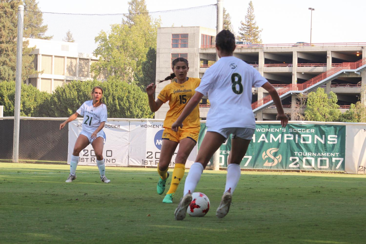 Sacramento+State+senior+forward+Kylee+Smith+attempts+to+dribble+the+ball+past+Cal+Golden+Bears+forward+Miranda+Nild+Friday+at+Hornet+Field.+Sac+State+lost+to+Cal+2-1+in+double+overtime.