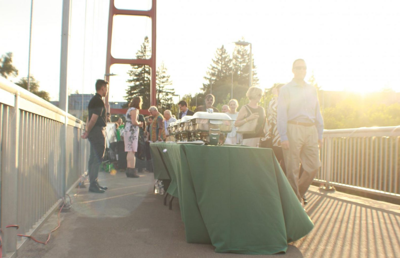 Diners of the event line up on the Guy West Bridge Wednesday for the buffet-styled dinner with food prepared by on-campus restaurant Epicure. (Molly Berg – The State Hornet)