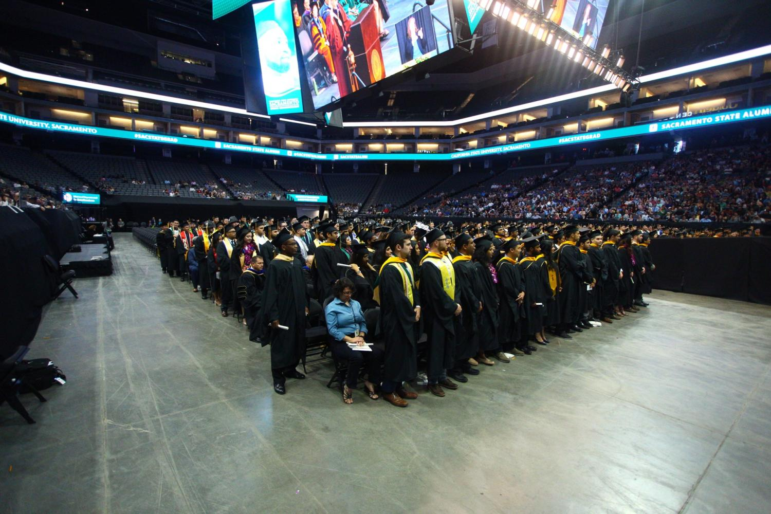 Graduates stand during the spring 2016 commencement ceremony at the Golden 1 Center in May.