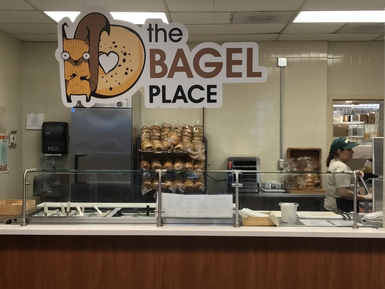 Yaneli Manzo performs her work duties at The Bagel Place in the River Front Center on Sept. 5. The Bagel Place replaced RF Greens, which specialized in customizable salads, with custom bagels featuring special toppings and schmears.