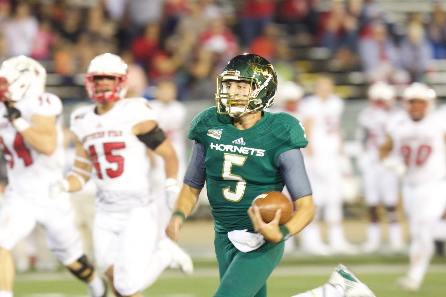 Sacramento State junior quarterback Kevin Thomson races down the field for a 59-yard rushing touchdown against Southern Utah Sept. 23 at Hornet Stadium. Thomson finished with 14 carries for 149 yards and four touchdowns.