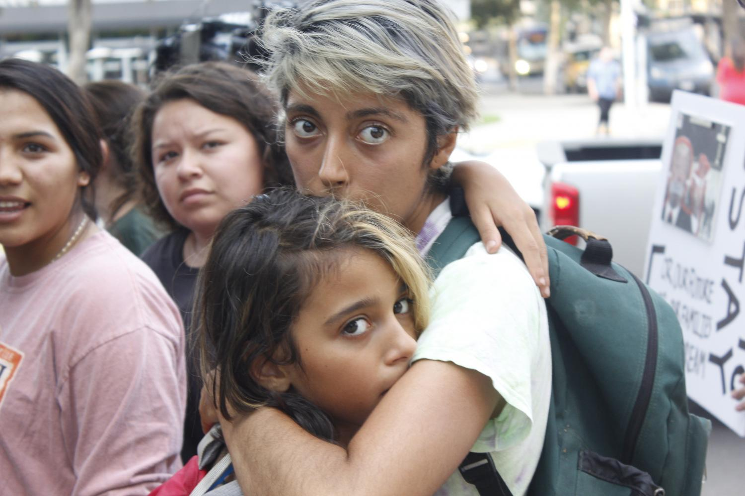 Diana Monroy hugs her daughter during a protest at Capitol Mall in Sacramento on Sept. 5. The protest was in response to the Trump administration's announcement that it would seek to end Deferred Action for Childhood Arrivals.