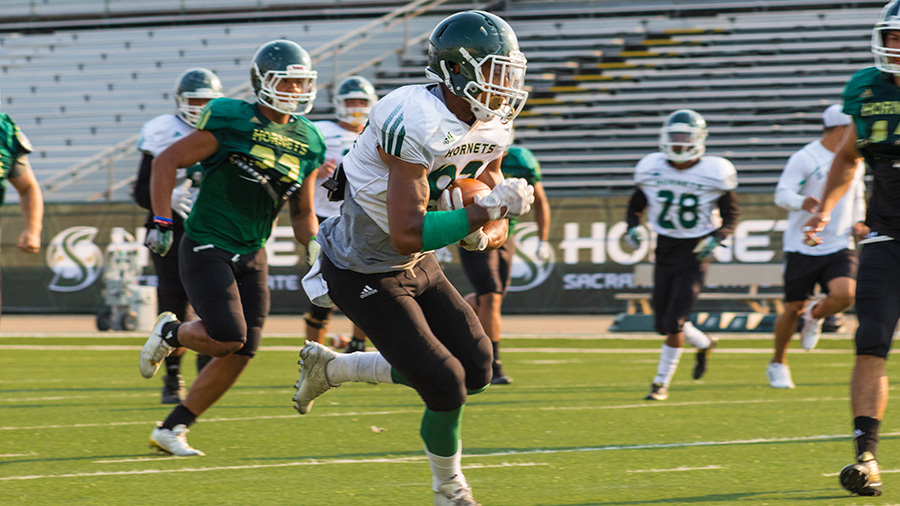 Sacramento+State+freshman+wide+receiver+Jeremiah+Foster+runs+down+field+after+making+a+catch+during+training+camp+Aug.+21+at+Hornet+Stadium.+