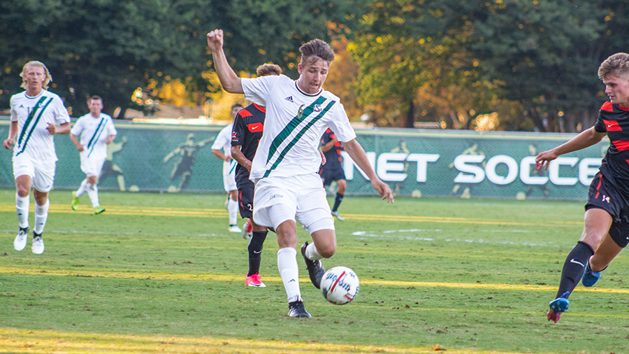 Sacramento State freshman forward Justin Bedig gets control of the ball as he works downfield against the University of the Pacific Aug. 26 at Hornet Field. Bedig is one of 10 freshmen to join the team this season.