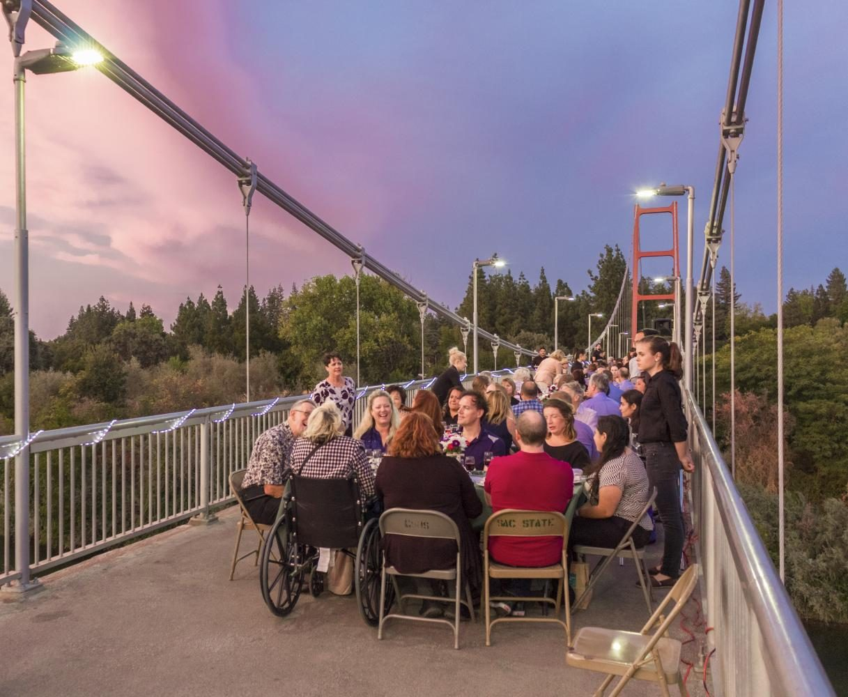 Guests of the second annual Sacramento State Farm-to-Fork dinner on the Guy West Bridge sit at their tables, waiting to be served by the student servers from on-campus restaurant Epicure on Wednesday. This year's dinner focused on the lives of farm laborers and their work.