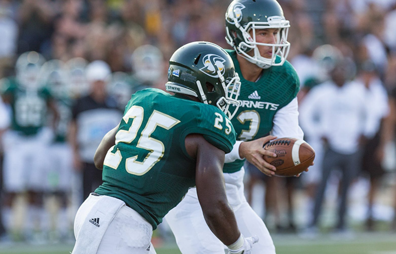 Sacramento State senior quarterback Kolney Cassel hands the ball to graduate transfer running back Joseph Ajeigbe against the University of Incarnate Word Saturday, Sept. 9 at Hornet Stadium. The Hornets came away with their first win of the season by the score of 56-22.