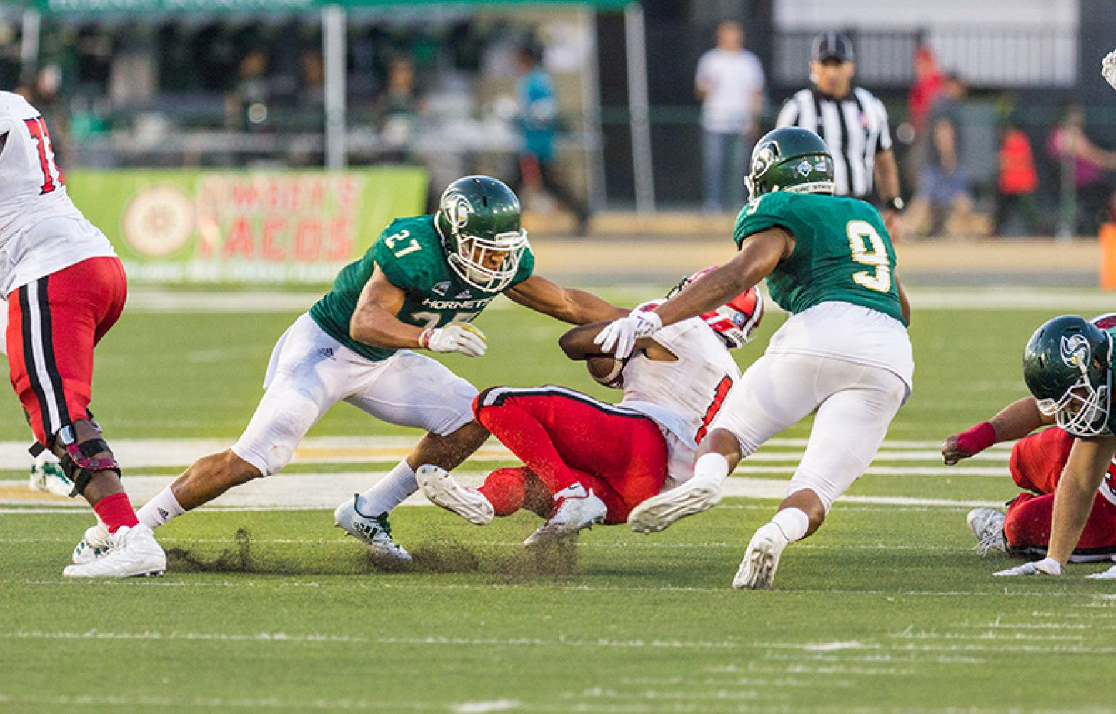 Sacramento State sophomore defensive back Quincy Jountti, left, and junior linebacker Malcom Thomas, right, take down University of the Incarnate Word running back Desmond Hite, center, Saturday, Sept. 9 at Hornet Stadium. Sac State won the game 56-22 to advance to 1-1 on the season.