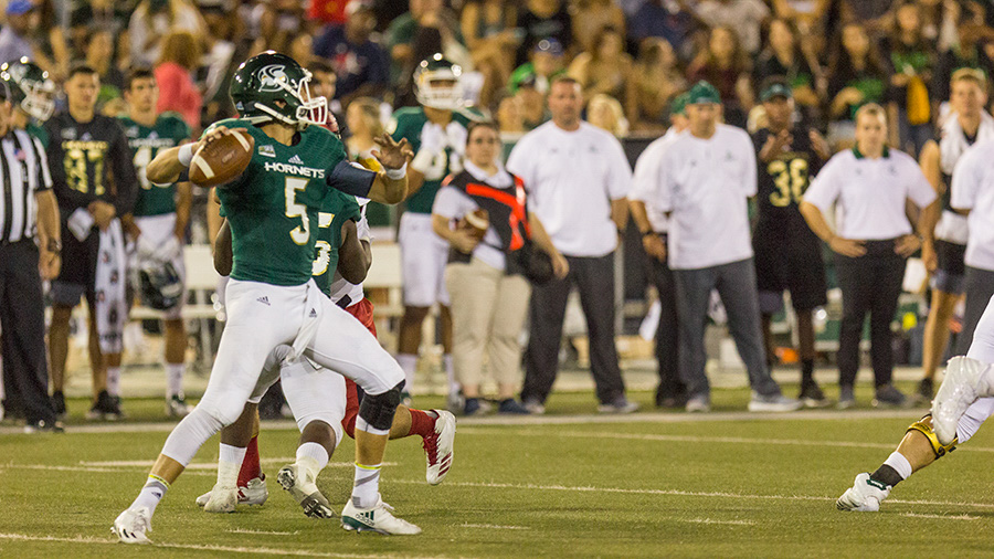 Sacramento State junior quarterback Kevin Thomson sets in the pocket to throw the ball downfield during the Hornets home opener against the University of Incarnate Word Sept. 9 at Hornet Stadium.