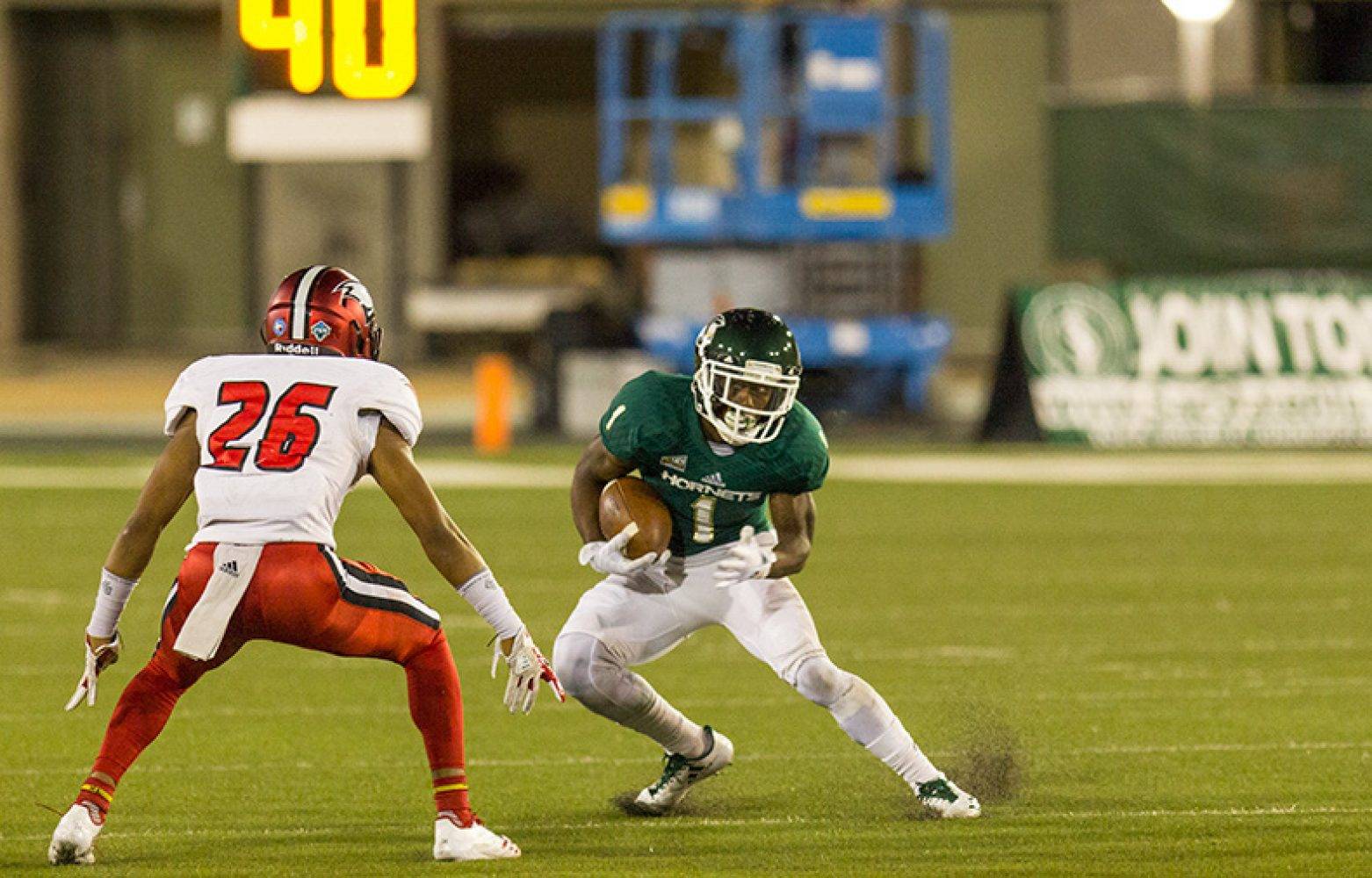 Sacramento State senior receiver Isiah Hennie tries to make a cut on the University of Incarnate Word's  Marquis Britten Saturday, Sept. 9 at Hornet Stadium. Sac State defeated UIW by the score of 56-22.