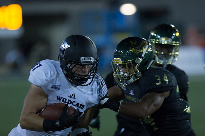 Sacramento State junior linebacker Marcus Bruce attempts to stop Weber State senior tight end Andrew Vollert Saturday, Sept. 16 at Hornet Stadium. Sac State lost to the Weber State Wildcats 31-24.