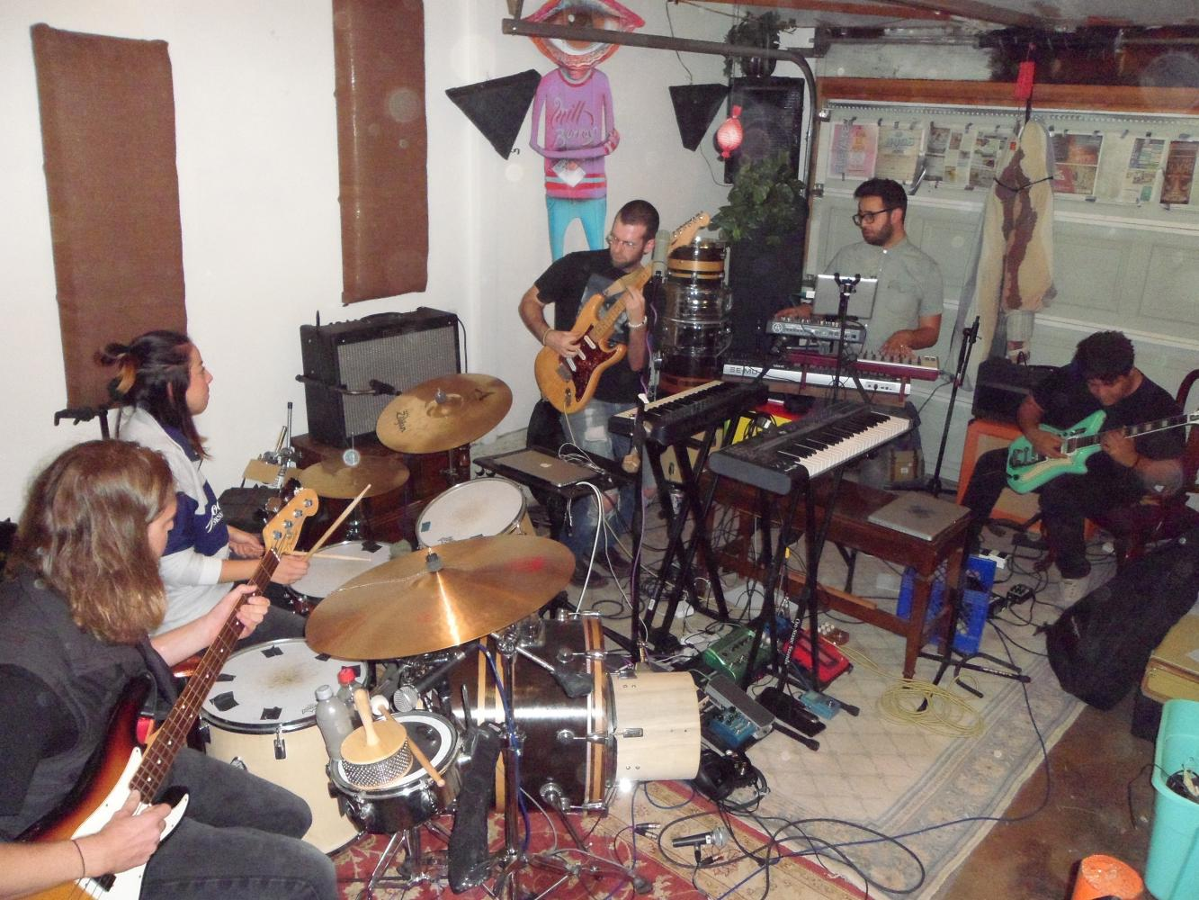 Members of the psychedelic pop band Petaluma hold a practice sesion in their garage studio on Sept. 20 ahead of their performance at City of Trees music festival. The band halts practice by 9 p.m. so as to not disturb their neighbors.