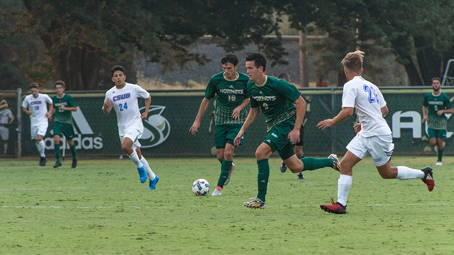 Sacramento State junior forward Brad Bumgarner runs past CSU Bakersfield opponents Friday, Sept. 1 at Hornet Field. The Roadrunners defeated Sac State 1-0 in overtime.