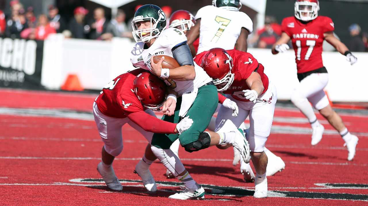 Sacramento State junior quarterback Kevin Thomson is tackled by two Eastern Washington defenders Saturday at Roos Field in Cheney, Washington.
