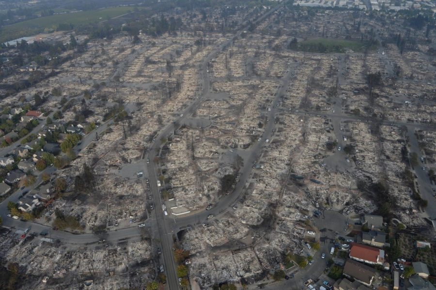 Aerial photographs from the California National Guard show entire neighborhoods leveled by burnings. At least 5,700 buildings have been destroyed in the fires spreading across Northern California since Oct. 8, according to state officials.