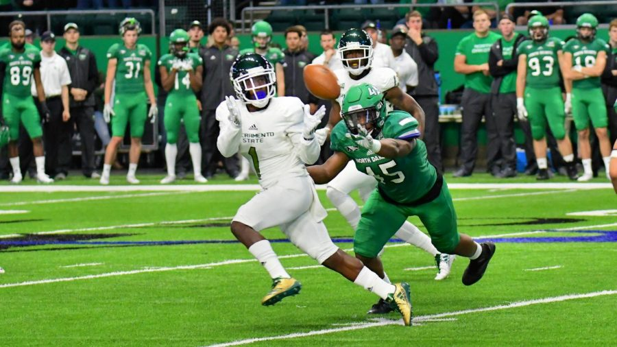 Sacramento State senior receiver Isiah Hennie prepares to make a reception while being guarded by North Dakota freshman linebacker Cameron Hunt Saturday, Oct. 21 at the Alerus Center in Grand Forks, North Dakota. Sac State defeated North Dakota 34-27.