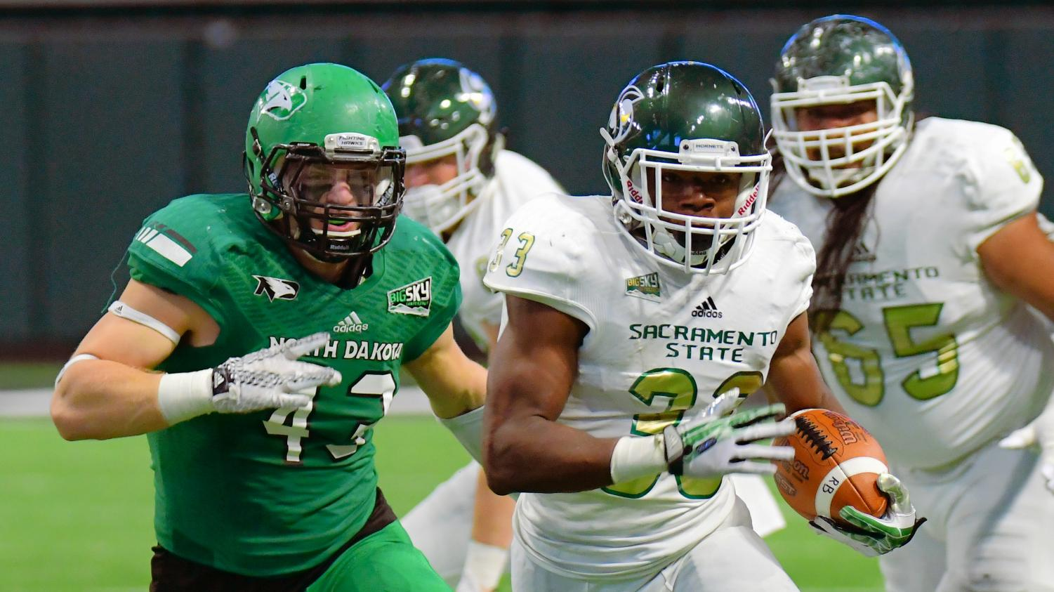 Sacramento State freshman running back Elijah Dotson rushes past North Dakota senior defensive lineman Drew Greely Saturday, Oct. 21 at the Alerus Center in Grand Forks, North Dakota. Sac State defeated North Dakota 34-27.