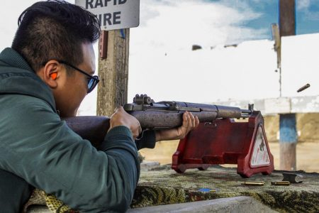 Digital Editor Vu Chau shoots a rifle at the Cordova Shooting Center on Oct. 20.