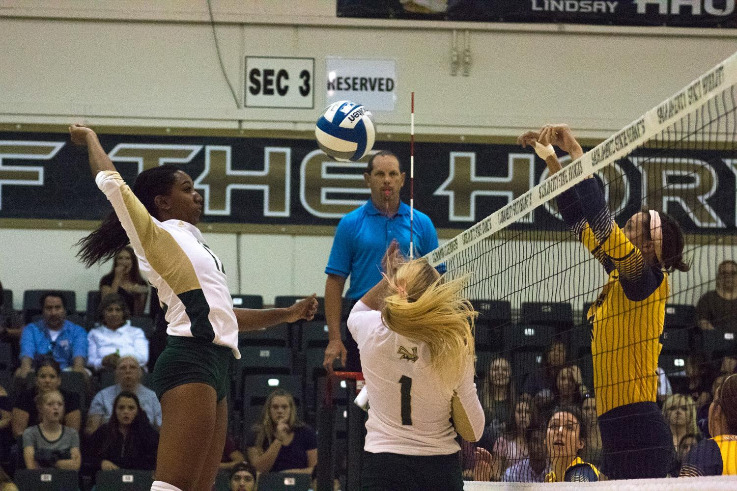 Sacramento State junior middle blocker Brie Gathright jumps to spike the ball against Northern Colorado Saturday, Oct. 7 at Colberg Court. Sac State defeated Northern Colorado 28-26, 25-22 and 25-17 in three sets.