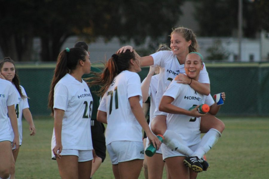 Sacramento State senior forward Andrea Boehm, top right, celebrates with teammates after tying with Northern Arizona Friday, Oct. 27 at Hornet Field. The Hornets' draw clinched them a spot in the Big Sky Tournament.