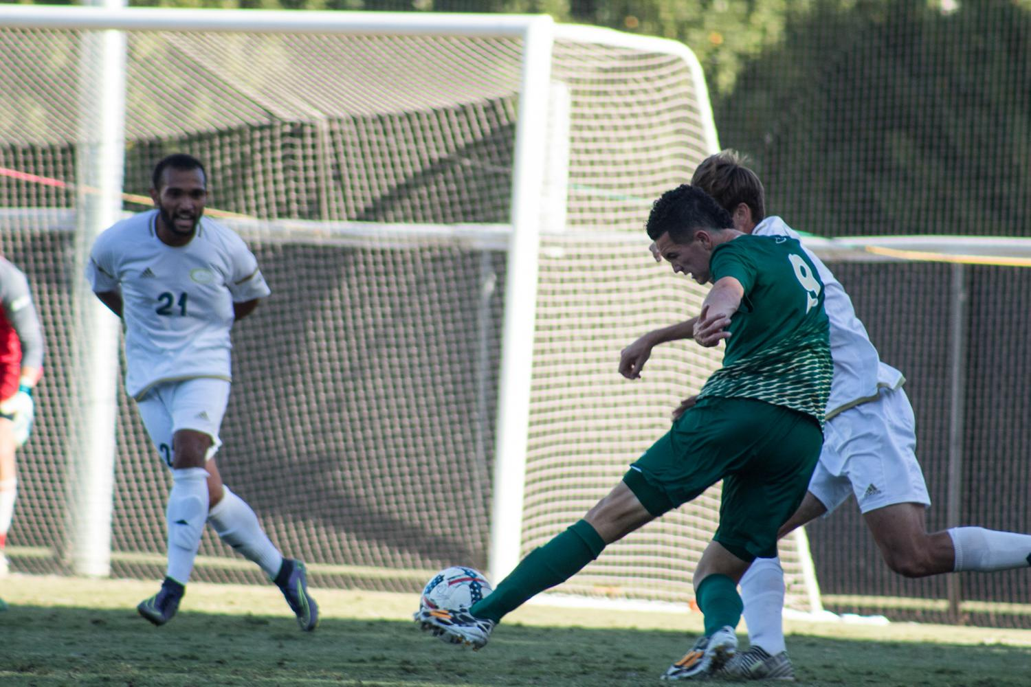 Sacramento State sophomore forward Christian Webb attempts a shot against UC Davis. Saturday, Oct. 14 at Hornet Field. Sac State attempted six shot attempts to UC Davis' 14 during its 2-0 loss.