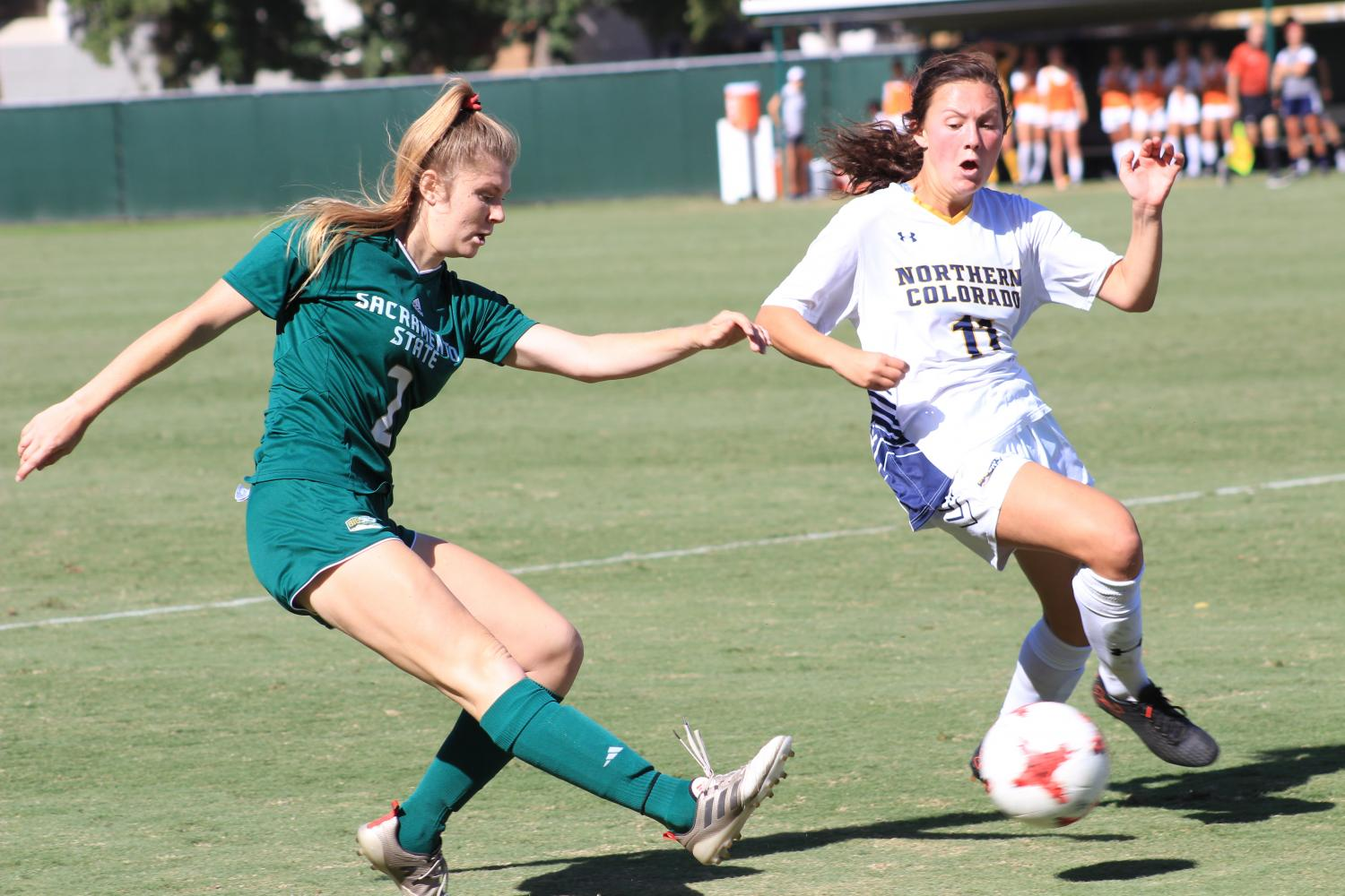 Sacramento State freshman midfielder Skylar Littlefield kicks the ball past Northern Colorado freshman defender Cara Quinn Oct. 1 at Hornet Field.