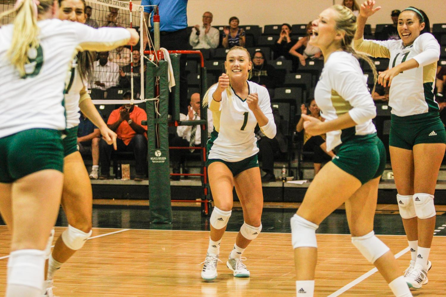 Sacramento State senior setter Kennedy Kurtz, middle, celebrates with teammates after a kill by senior outside hitter Shannon Boyle in set five against North Dakota at Colberg Court in the Nest on Thursday, Oct. 5, 2017. After defeating Portland State on Oct. 7, Sac State clinched its first Big Sky Conference regular season championship since 2007.