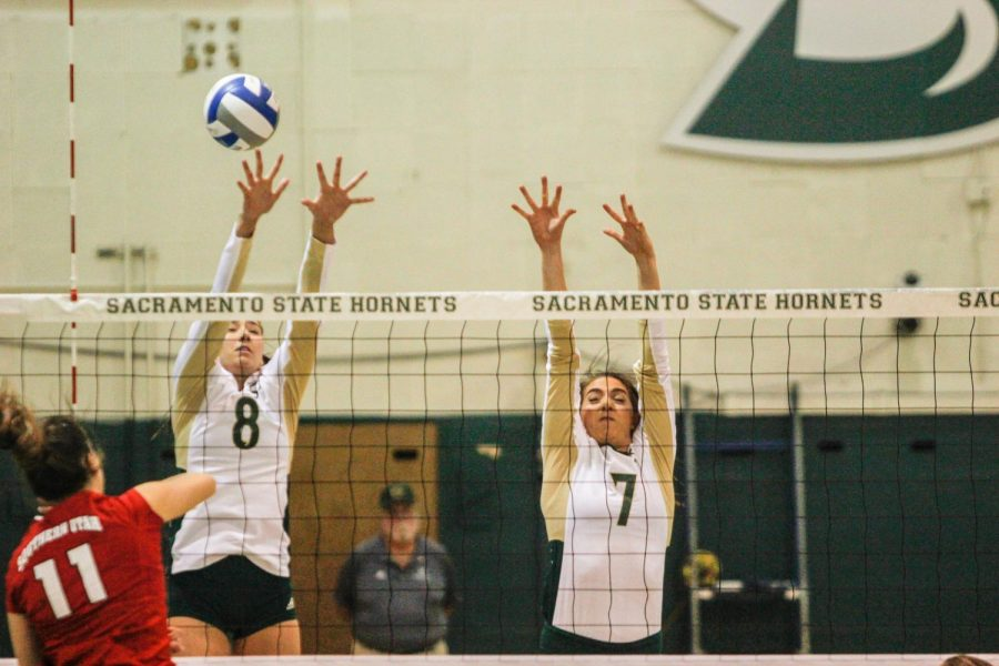 Sacramento State sophomore outside hitter Sarah Davis, left, and junior middle blocker Lana Brown, right, go for a block against Southern Utah Thursday, Oct. 12 at Colberg Court.