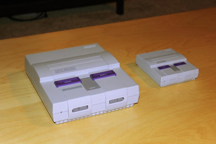 The Super Nintendo Entertainment System Classic Edition, right, sitting next to the original version, left, which was released in 1991. Unlike the original, the SNES Classic Edition doesn't use interchangeable cartridges but instead has 21 games built right in.