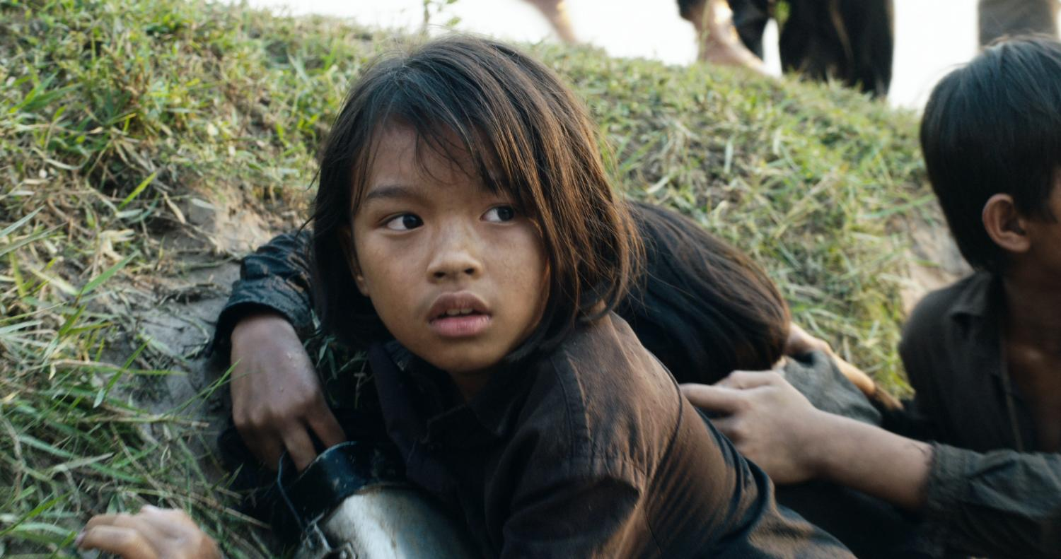 Making her on-screen debut, 9-year-old Sreymoch Sareum portrays Loung Ung in