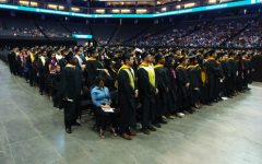 Graduates stand at the spring 2017 commencement ceremony at Golden 1 Center. Sac State announced that graduation will take place over the course of three days for the Spring 2019 ceremony.