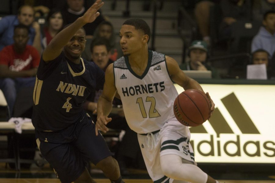 Sacramento State junior guard Jordan Tolbert dribbles past Notre Dame de Namur University sophomore guard Stephen Baity Tuesday, Nov. 14 at the Nest. Tolbert finished with eight points, seven assists, two steals and just one turnover in a 74-53 home-opening win over NDNU.