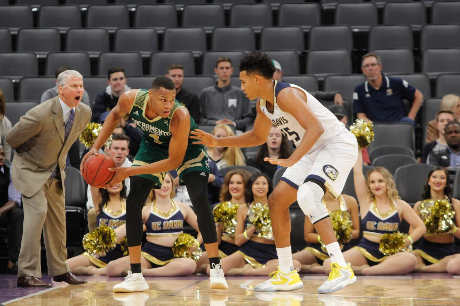 Sacramento State senior forward Justin Strings protects the ball against UC Davis junior forward AJ John Tuesday, Nov. 21 at the Golden 1 Center. Strings posted 17 points, 12 rebounds and 10 turnovers in a 64-47 loss against the Aggies.